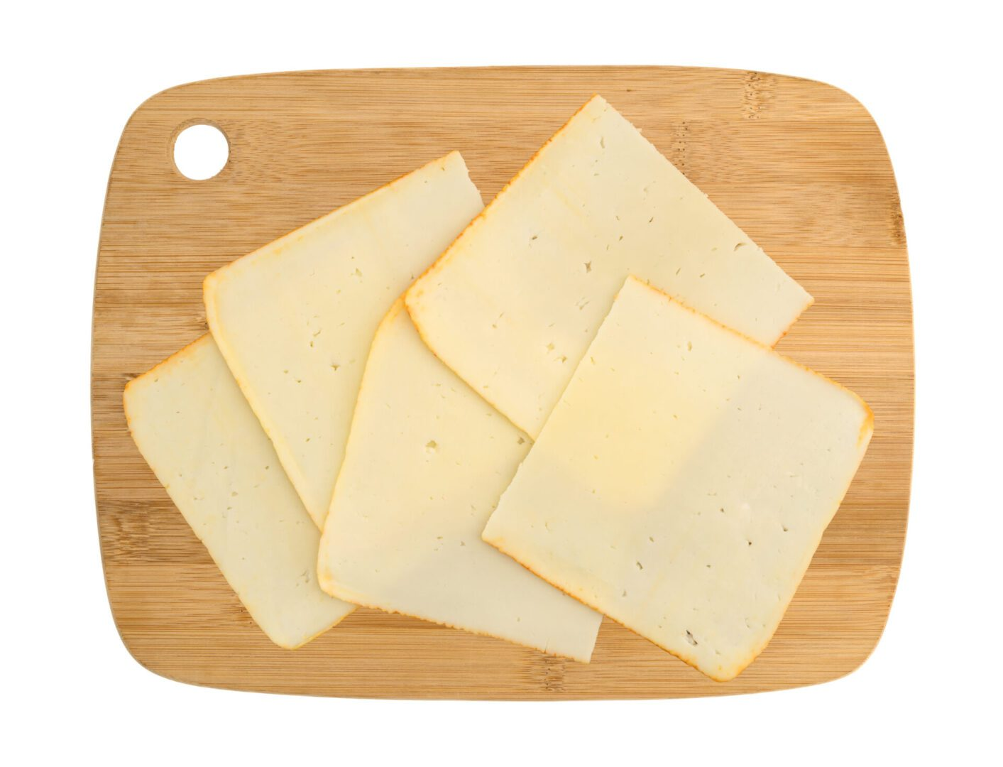 Top,View,Of,Muenster,Cheese,Slices,On,A,Wood,Cutting